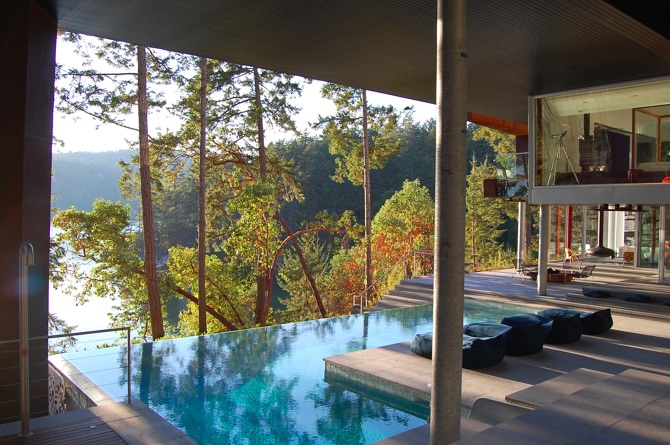 Modern Steel West Coast fusion building exterior pool to ocean on Pender Island built by Dave Dandeneau of Gulf Islands Artisan Homes