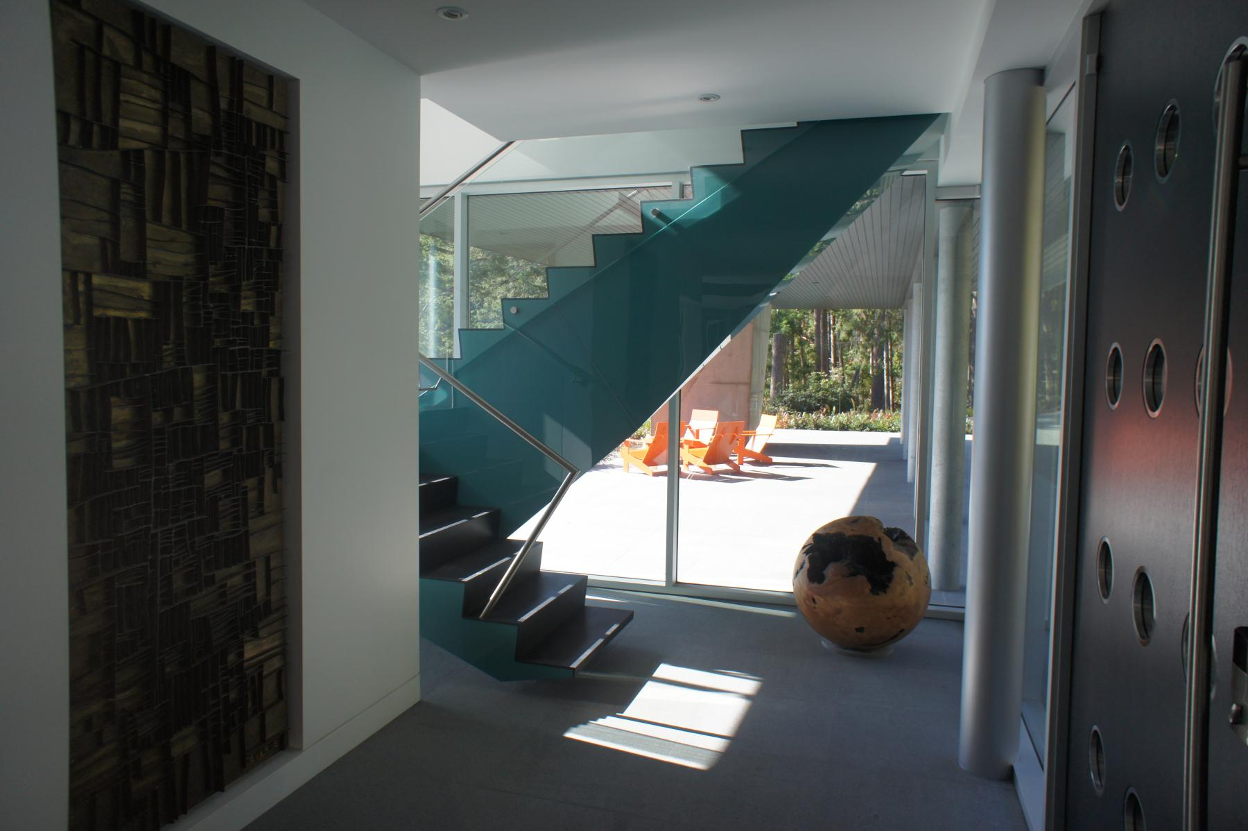 Modern Steel West Coast fusion building staircase on Pender Island built by Dave Dandeneau of Gulf Islands Artisan Homes