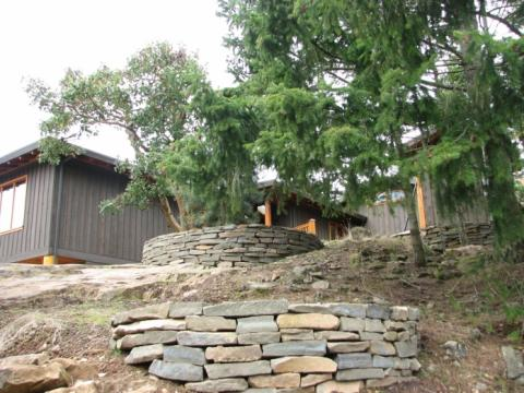 Exterior stone masonry landscaping of West Coast Home on Pender Island built by Dave Dandeneau of Gulf Islands Artisan Homes