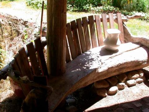 Exterior driftwood bench  on Pender Island built by Dave Dandeneau of Gulf Islands Artisan Homes